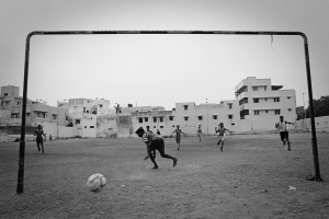 A group of boys play soccer on a field adjacent to the K.M. Garden Community, home to 60,000 people living in close proximity in Chennai, India.