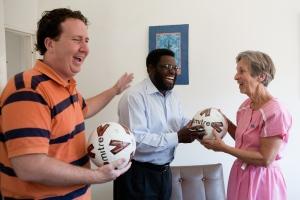 Steven and Pastor John Chinyowa handing over balls to headmistress of Lendy Park School in Marondera, Zimbabwe.