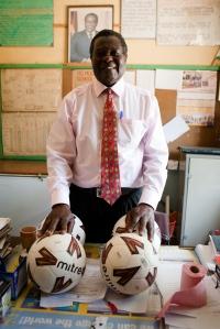 Principal of R.G. Mugabe Primary School in Marondera, Zimbabwe, receiving balls. (Most of the Musha Wevana children attend RG Mugabe)
