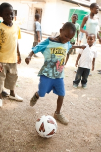 One is of the children at Musha Wevana children's home in Marondera, Zimbabwe playing with one of the new balls.