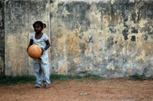 Girl in Chennai India with a soccer ball