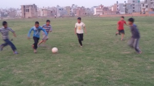 Kids in Nepal playing soccer