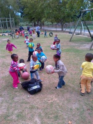 little kids with lots of balls