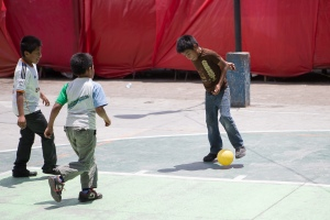 www.brianmcguckin.com - children in Brazil playing soccer