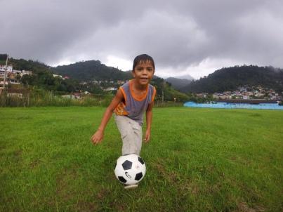 Bloomington to Brazil - Ball Project ball with a Brazilian boy