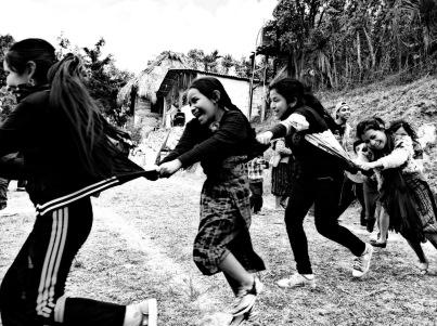 bw kids chasing in Guatemala