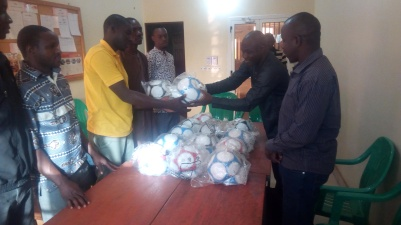 handing out new balls to coaches