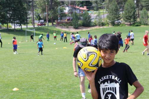 boy & ball at nwfm camp